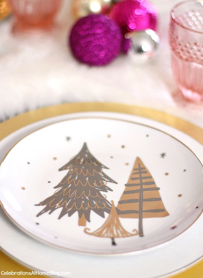 White & pink Christmas tablescape, plates with Christmas tree motif