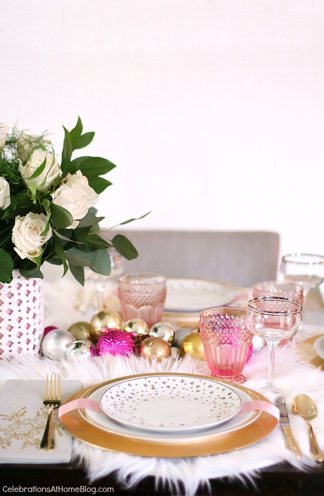 white & pink Christmas tablescape place setting with white roses in vase centerpiece