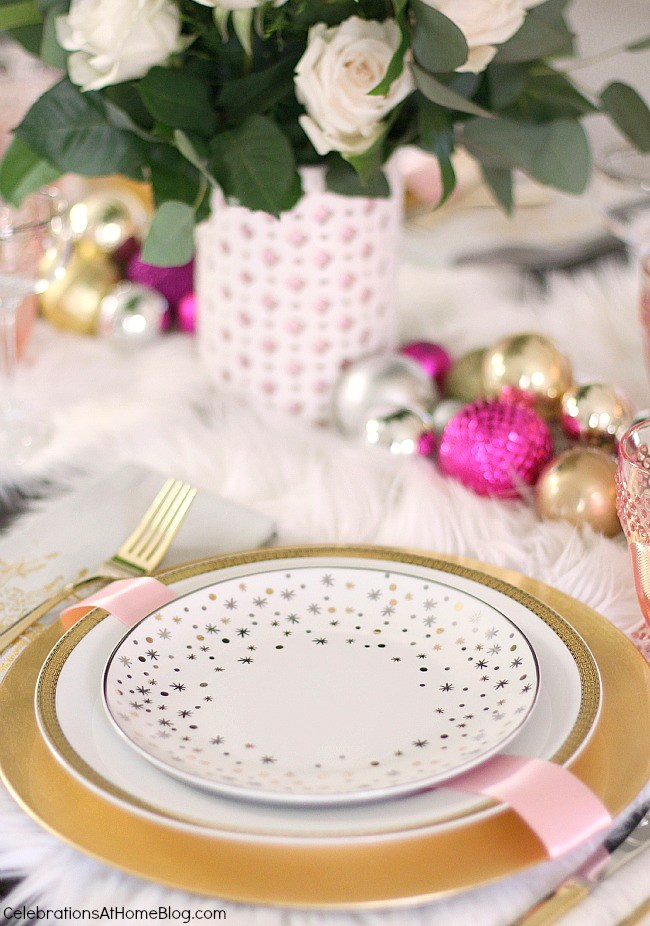 white & pink Christmas tablescape place setting with salad plate with star motif