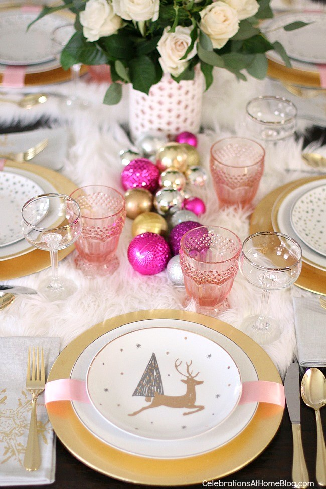 white & pink Christmas tablescape with ball ornaments as table runner