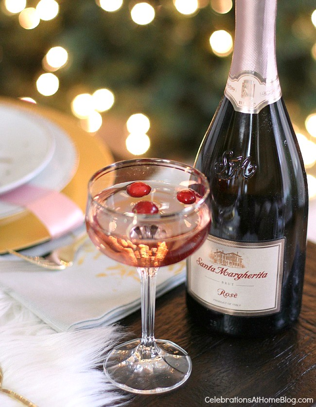 This white & pink Christmas table setting is perfect for celebrating the season with a girls night dinner party. Serve Rose sparkling wine of course!