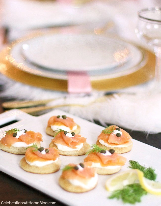 white & pink Christmas tablescape with salmon blini appetizers