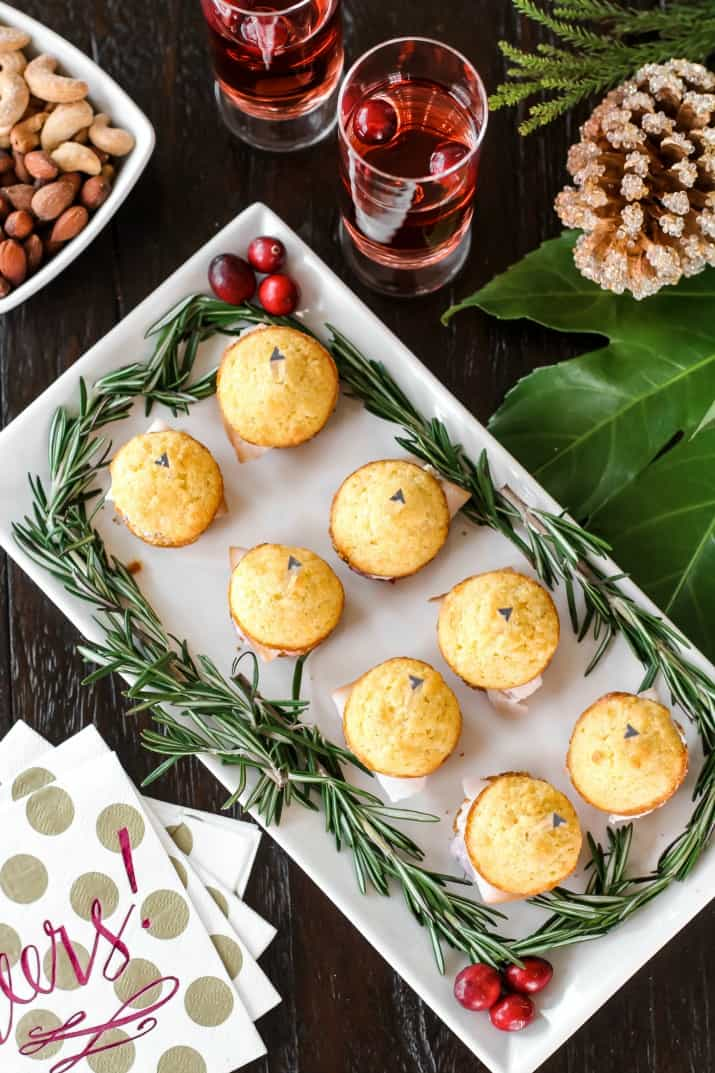 mini corn muffins on white platter overhead view
