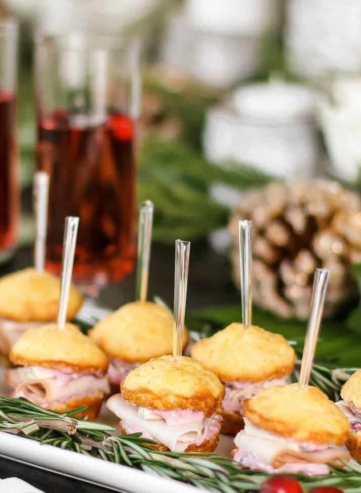 mini muffin sandwich appetizers on white plate