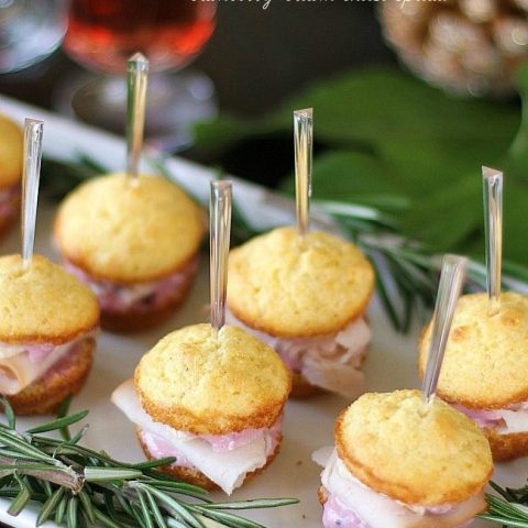 Party appetizers - Mini muffin sandwiches with turkey, brie, and cranberry-cream cheese spread