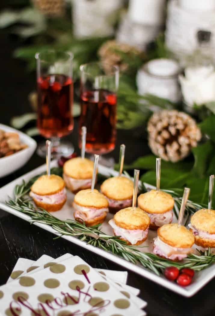 Christmas party appetizers on platter with rosemary garland