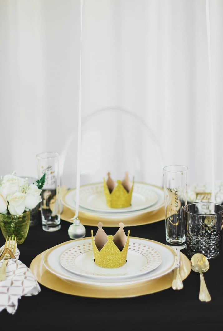black and gold holiday tablescape place settings