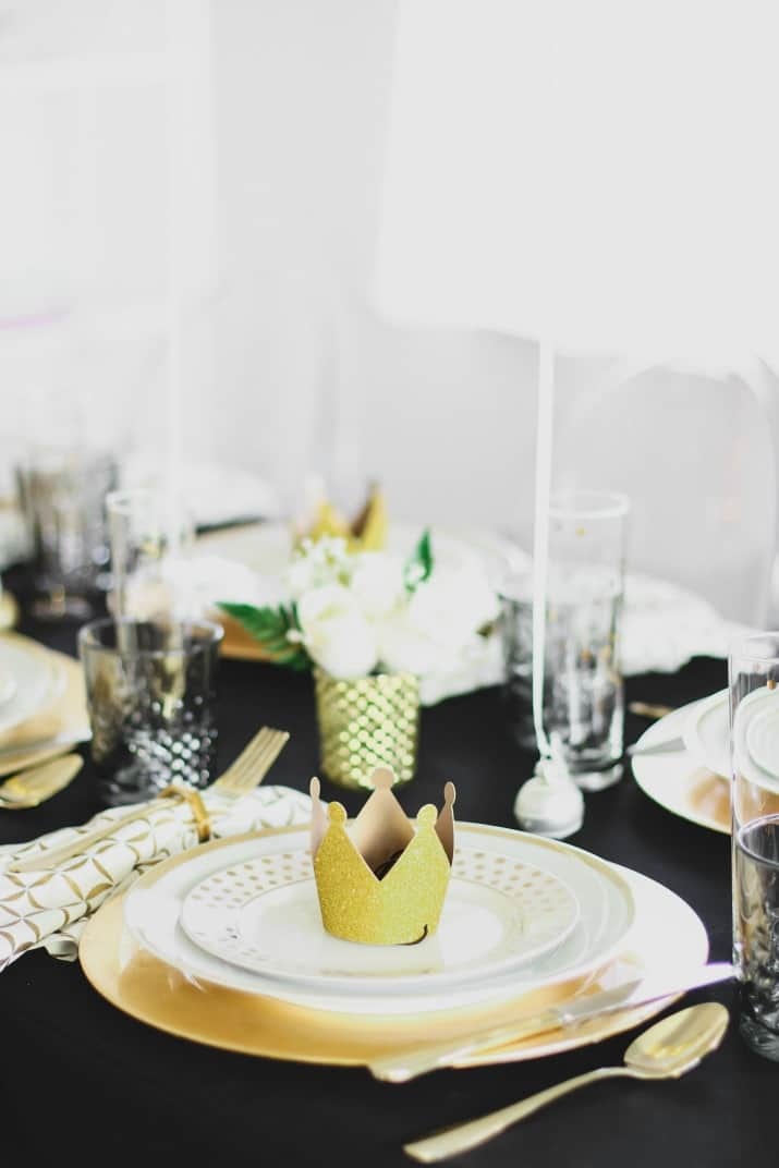 black and gold celebration tablescape place setting