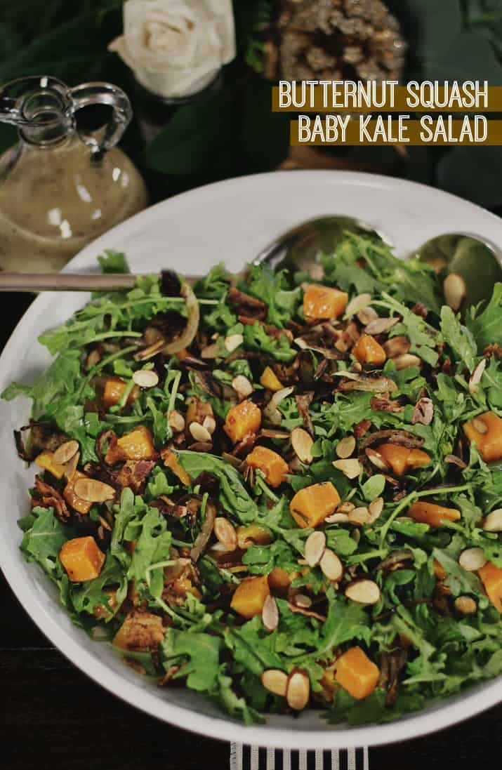 butternut squash baby kale salad in white serving bowl
