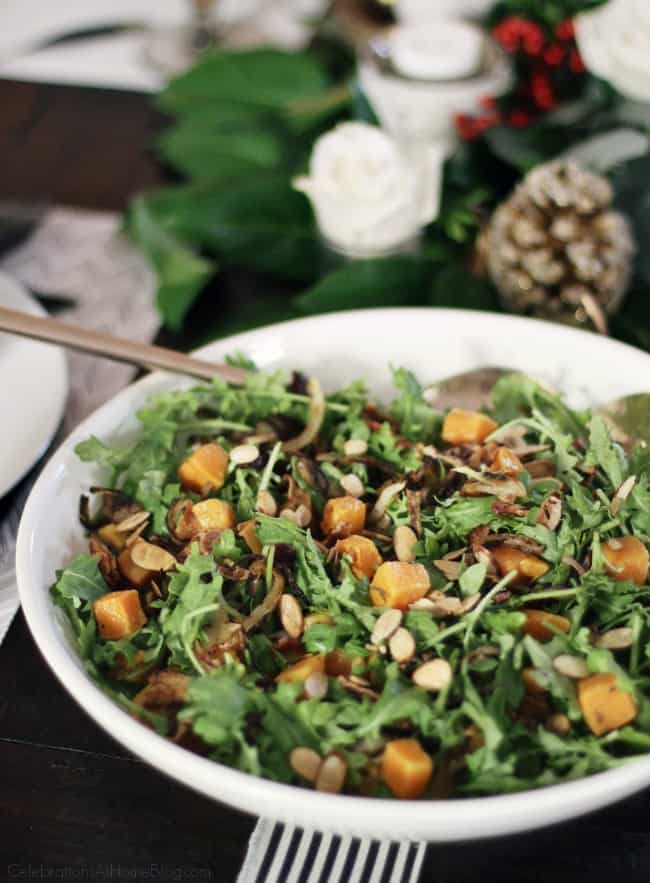 Butternut Squash Baby Kale Salad is a must-make winter salad for your entertaining menu. Make this part of your Thanksgiving side dishes or Christmas dinner too.  #salad #sidedish #Thanksgiving #Christmas