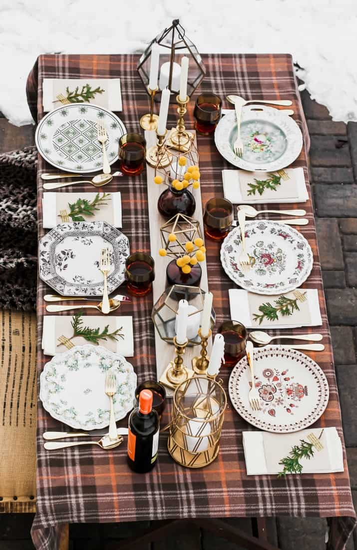neutral winter tablescape with plaid cover and vintage plates
