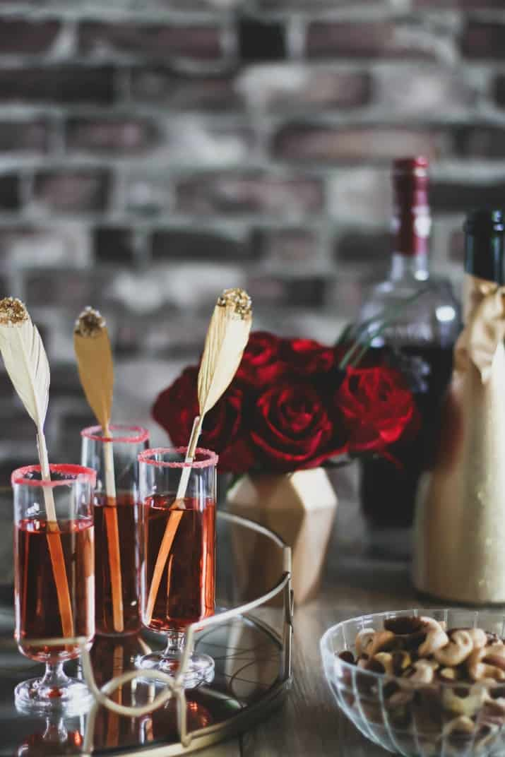 pomegranate sparkle cocktail, trio of glasses on gold tray