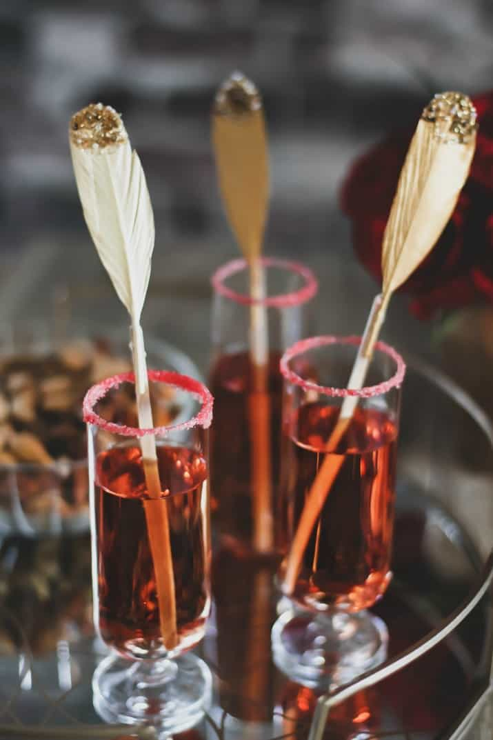 pomegranate sparkle cocktail, 3 glasses with feather stir sticks