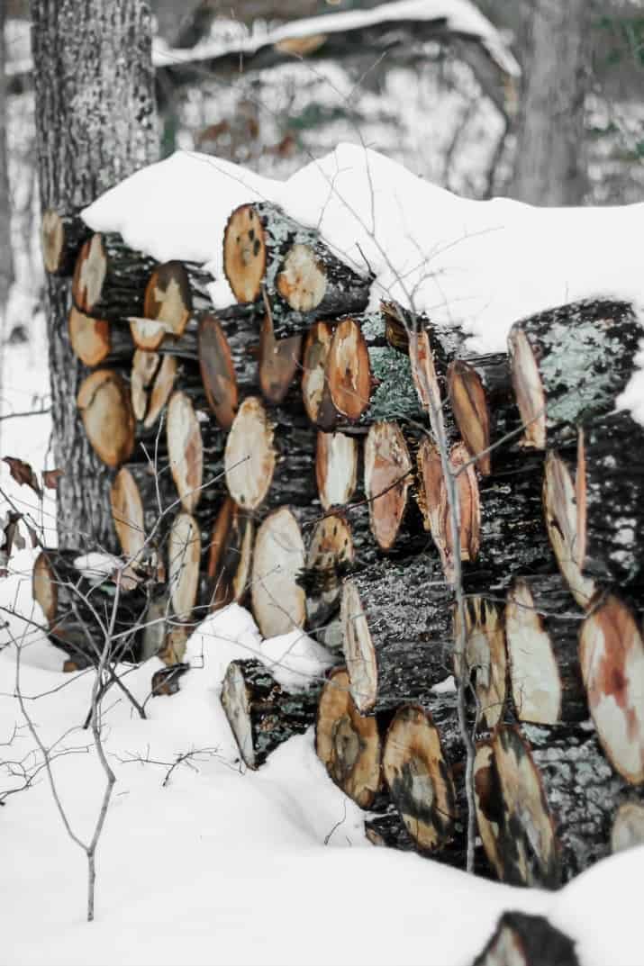 snow covered firewood stack