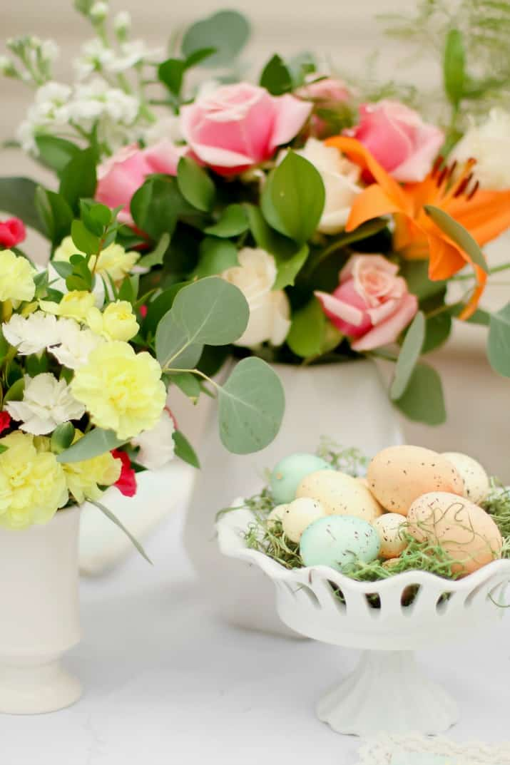 Easter centerpiece of flowers and speckled eggs