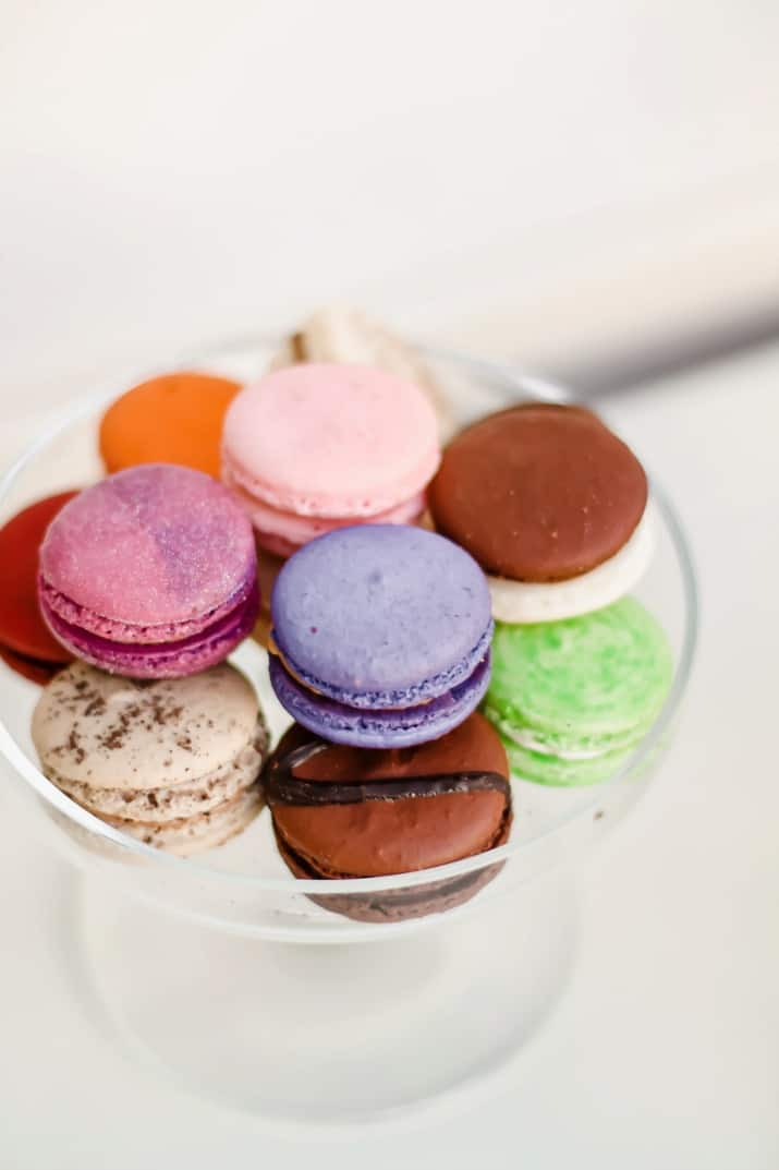 colorful macarons on glass dish