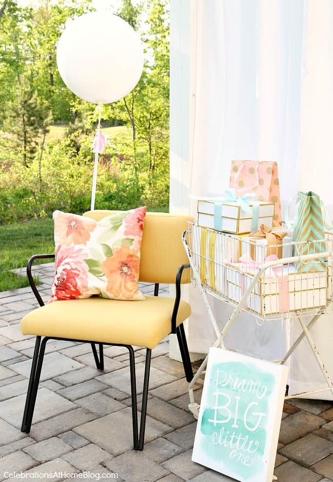 baby shower mom chair with gifts in a wire stand