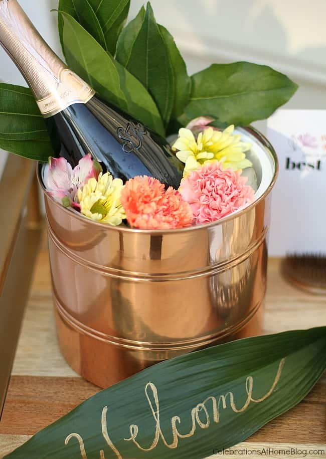 copper bucket with champagne bottle and flowers