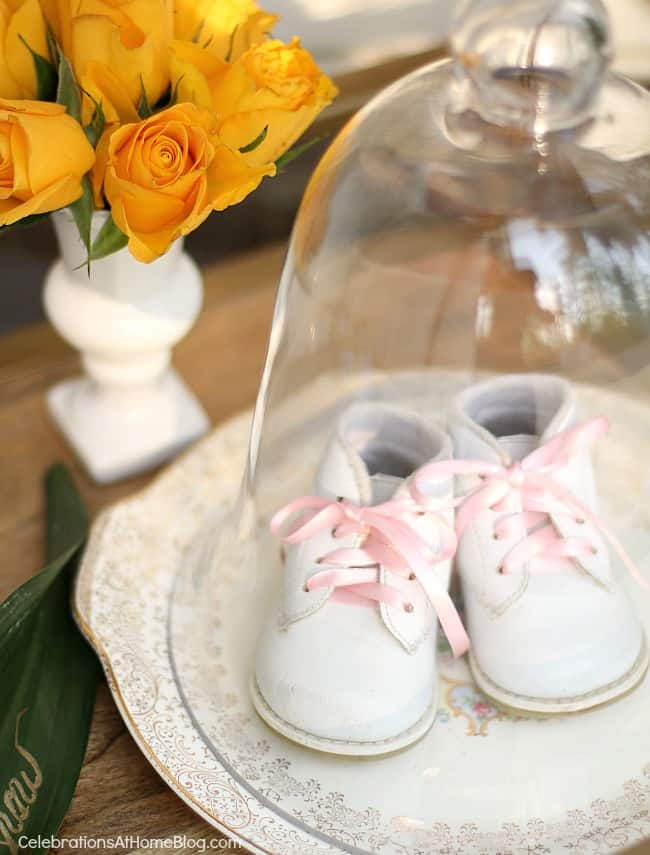 baby shoes under glass cloche