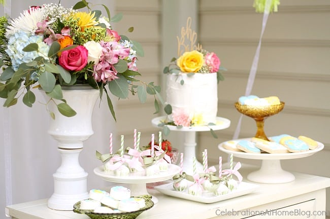 dessert table with vase of flowers cake mini desserts