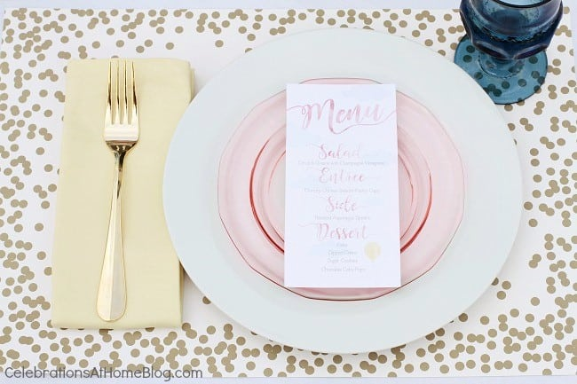 white dinner plate with pink salad plate and printed menu