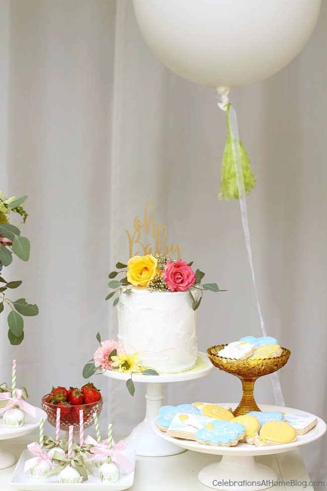 white cake and balloon on dessert table
