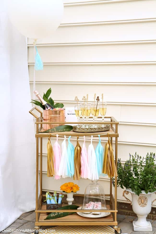 bar cart decorated for baby shower