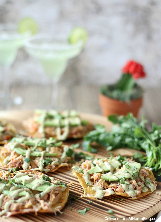 My cheesy chicken tostadas with creamy poblano sauce is a fiesta in your mouth! This may be my new favorite dinner or appetizer recipe!