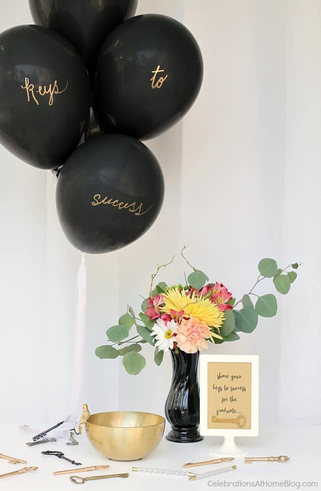 Set up this keys to success theme balloon display for guests to impart words of wisdom to the graduate, or the bride and groom. A great theme for both!