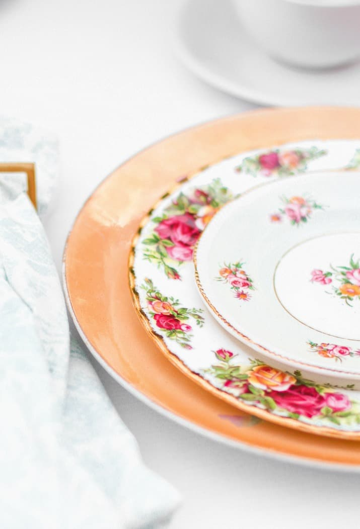 layered china plates for tea party