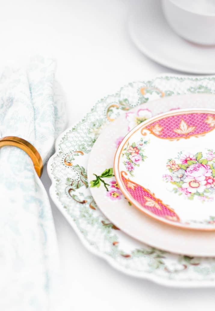 tea party brunch table with layered mix and match vintage plates