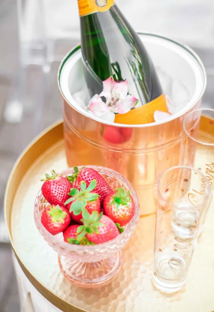 strawberries and champagne on tray