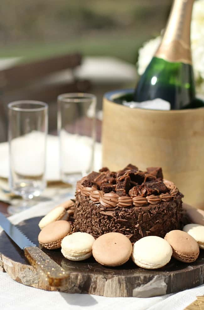 al fresco dinner party, chocolate cake on rustic slab