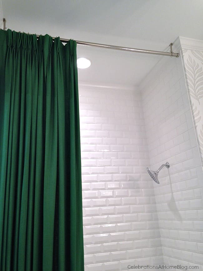 Hang shower rod from ceiling for height. These 12 unique home decor ideas are from a recent designer showcase tour.