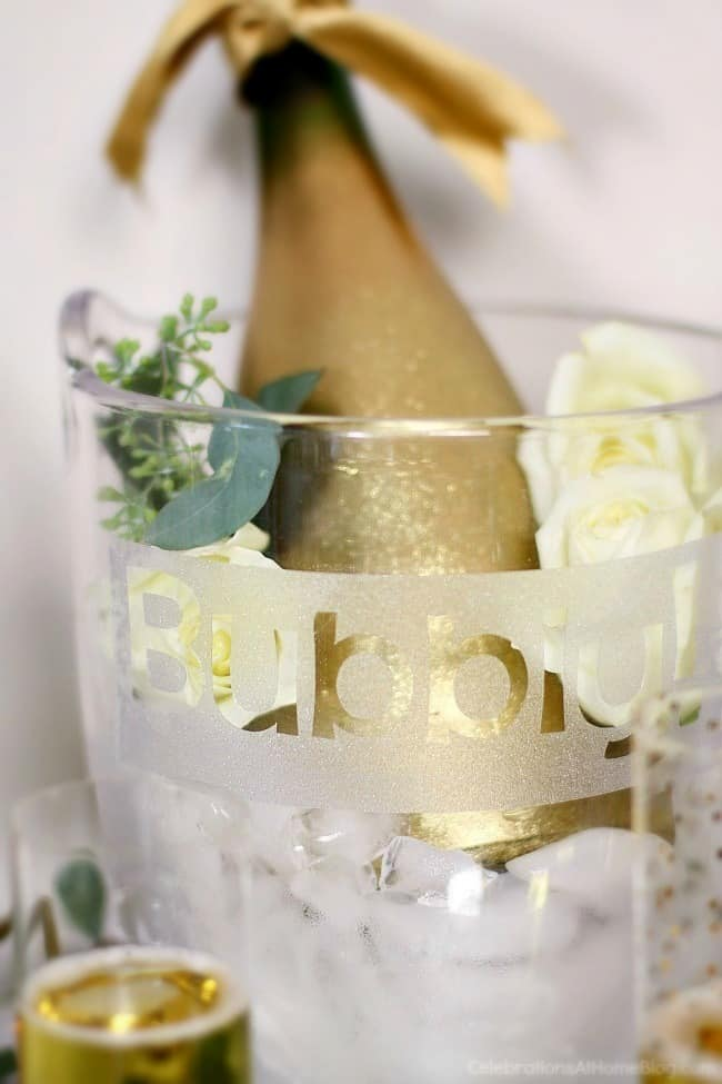 First anniversary party ideas you'll love; Gold and white dessert party. Champagne bucket.