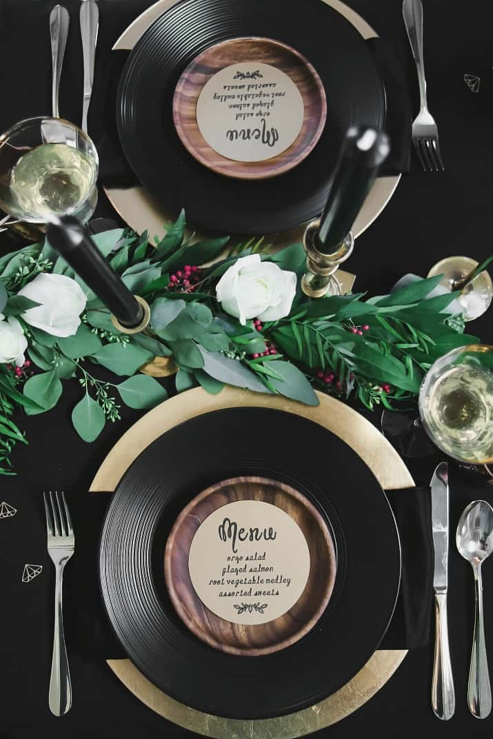 Black & gold place settings overhead view