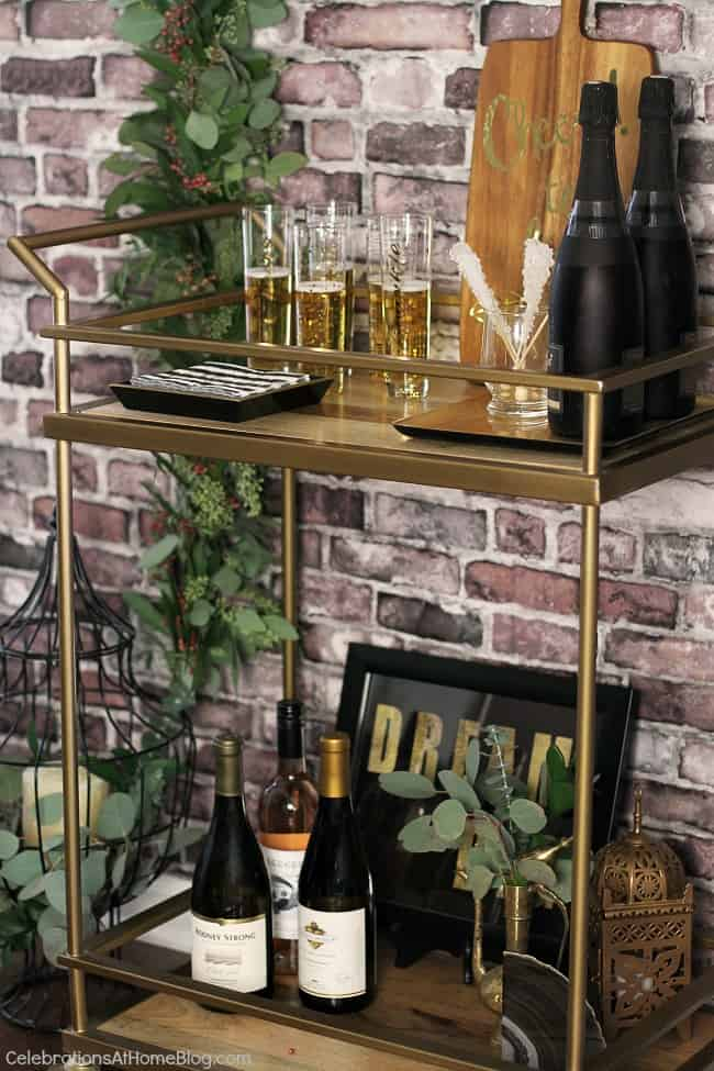 Black & gold bridal shower ideas for the do-it-yourself-er. A lovely styled shoot for a celebration at home | bar cart