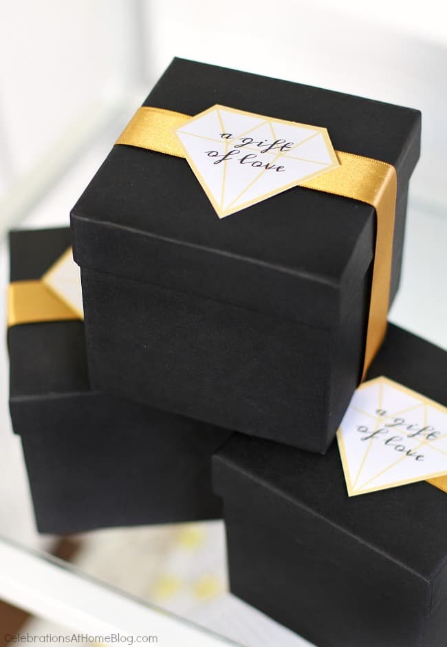 Black & gold bridal shower ideas for the do-it-yourself-er. A lovely styled shoot for a celebration at home | diy bridal shower favor box tags