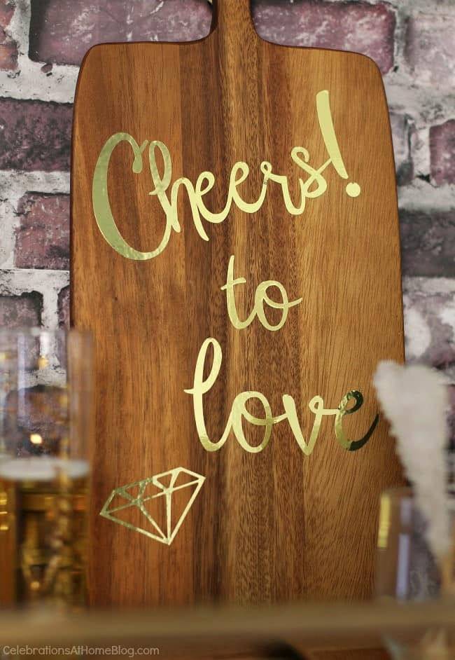 Black & gold bridal shower ideas for the do-it-yourself-er. A lovely styled shoot for a celebration at home | diy wood bar sign