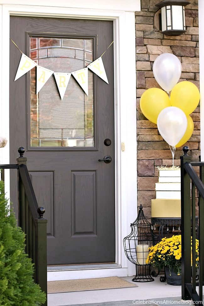 Outdoor birthday party decor with balloons; Welcome guests with these decorating ideas.