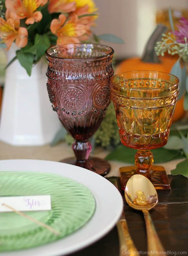 colorful Thanksgiving place setting, green plate, purple goblet, gold glass