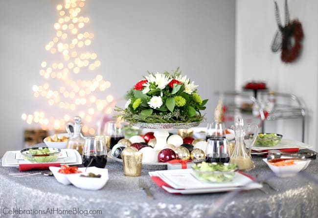 Get Christmas dinner entertaining tips from party stylist Chris Nease, to help you set a chic table for all those extra guests. Holiday entertaining; Christmas tablescape; Christmas bar cart ideas.