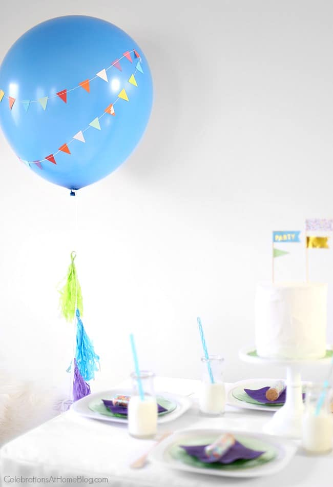 Make this diy party balloon with mini banner for your next party. It's the perfect accent to add for any celebration! balloon decor