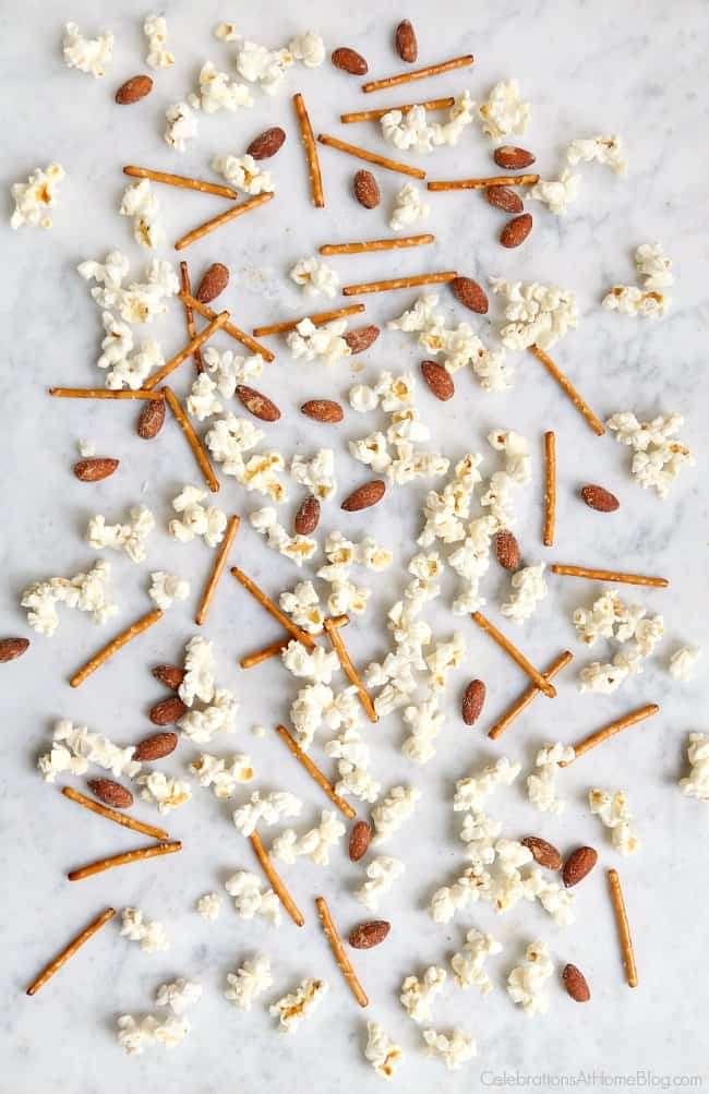 You're going to love our family's favorite popcorn snack mix that we've been making for years! It's a terrific after school snack; football party food, or Awards party mix.