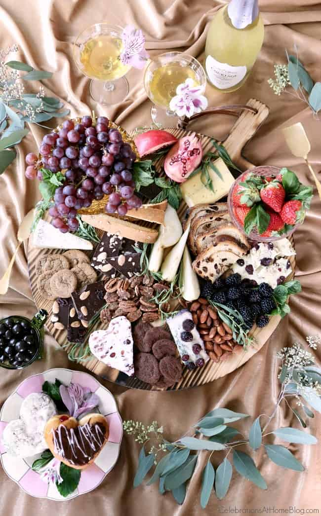 chocolate & cheese dessert board on gold cloth, top view
