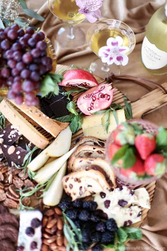 chocolate & cheese dessert board with fruit and champagne