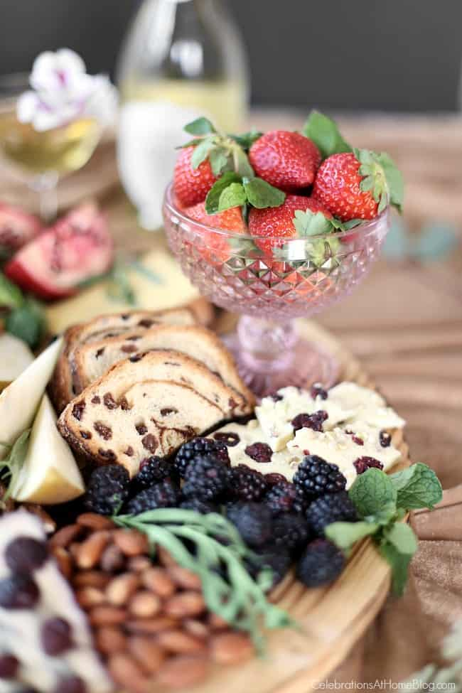 chocolate & cheese dessert board with strawberries and blackberries