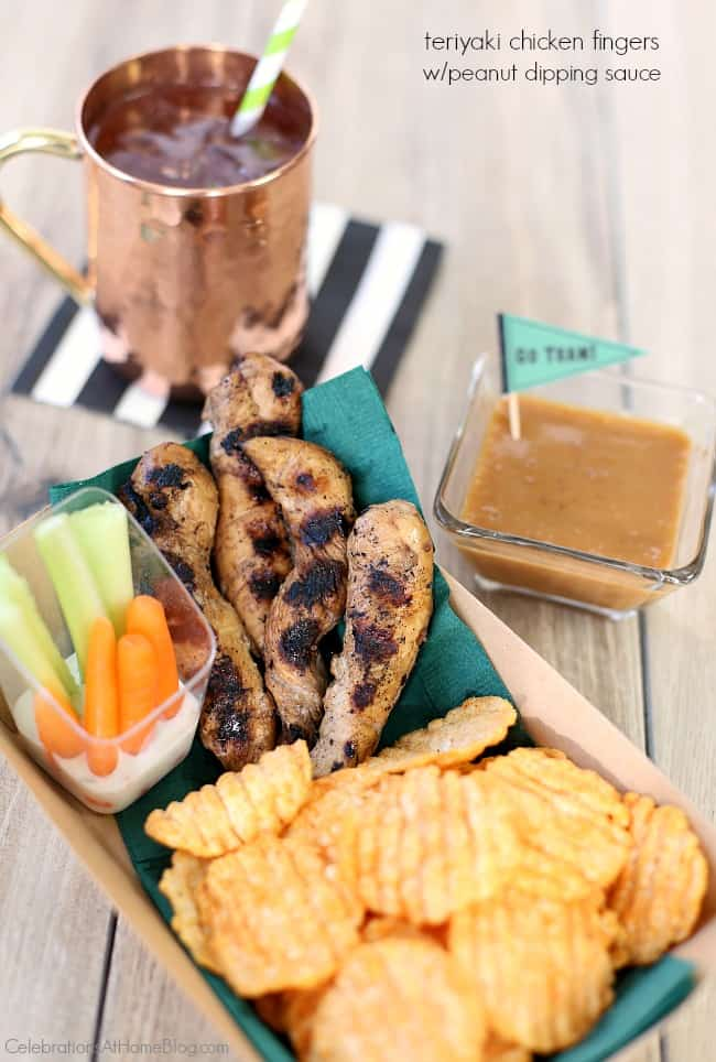 teriyaki chicken fingers with peanut dipping sauce served in paper food basket