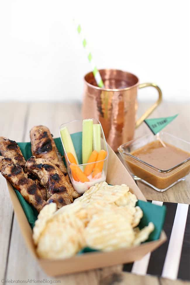 teriyaki chicken fingers with peanut dipping sauce served with popchips and crudites