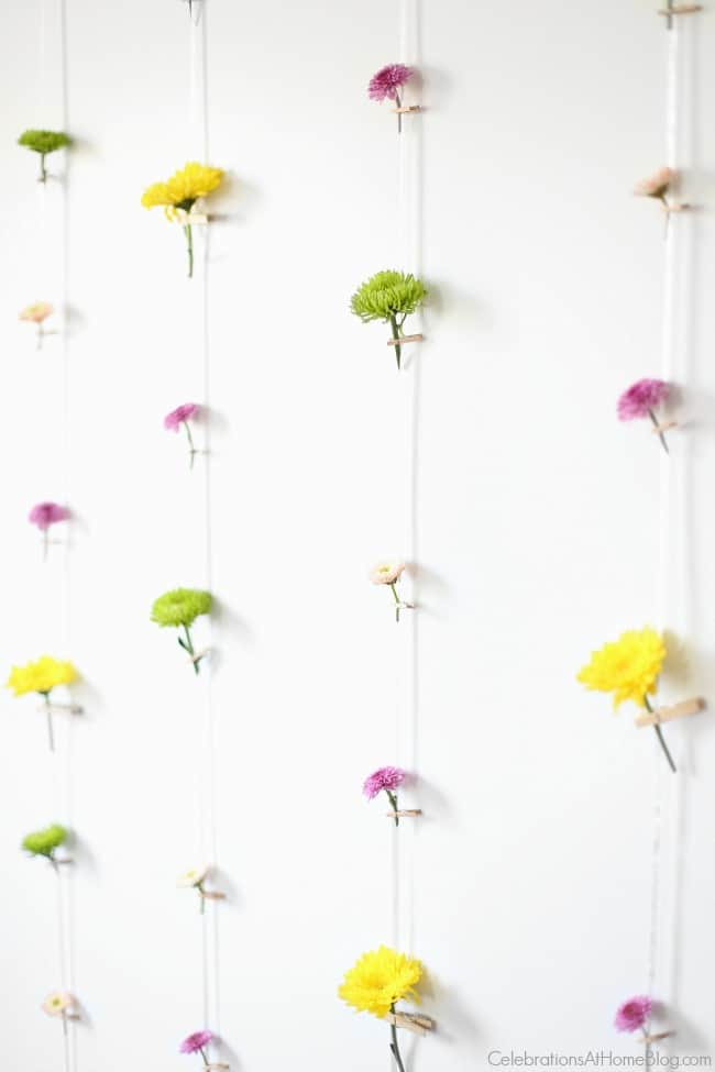 Set a beautiful Easter tablescape with a flower wall